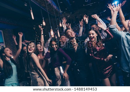 Portrait of wild cheerful crazy emotional lady guys having fun funny funky foolish good-looking elegant suit dress formalwear indoors discotheque