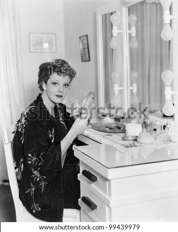 Portrait of woman at dressing table