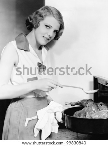 Portrait of woman basting bird