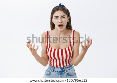 Portrait of woman being upset friend spoilt her bday shaking hands crying and yelling at camera frowning and whining complaining on anfair and cruel life over gray background
