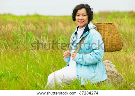Portrait of woman carrying basket