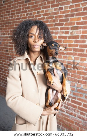 Portrait of woman carrying dog