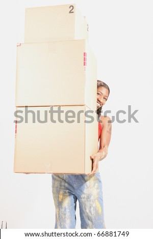 Portrait of woman carrying stack of boxes