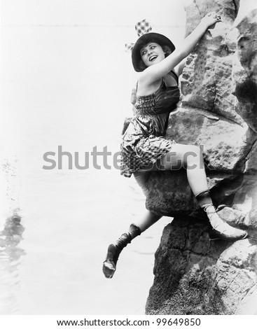 portrait of woman climbing rock ...
