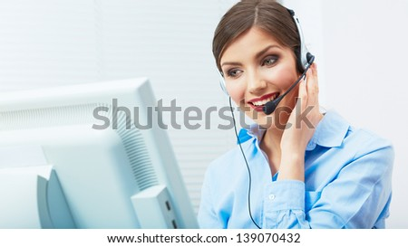 Portrait of woman customer service worker, call center smiling operator with phone headset. Young female business model.