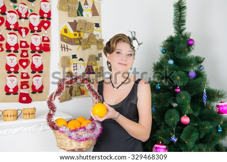 Portrait of woman decorating christmas tree. hostess decorates a Christmas tree before the holiday
