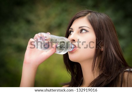 Portrait of woman drinking water outdoor