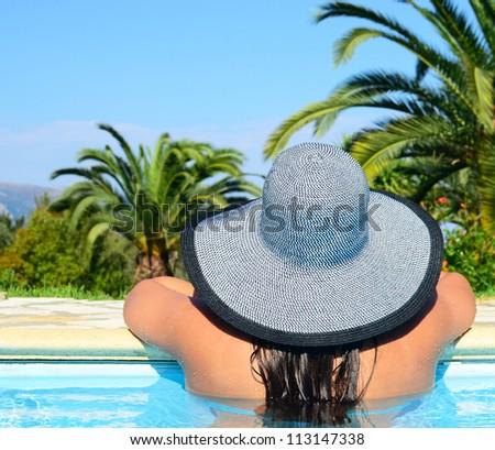Portrait of woman enjoying sun in swimming pool