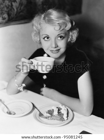 Portrait of woman having pie and coffee