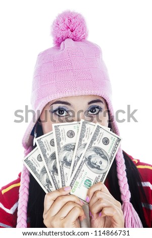 Portrait of woman holding five hundred dollar bills in hand.