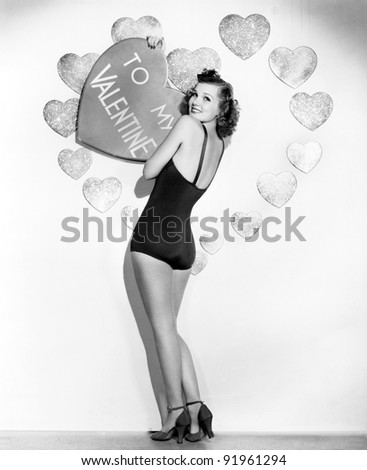 Portrait of woman holding large valentine
