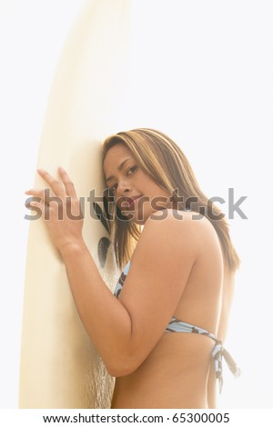 Portrait of woman holding surf board