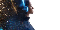 Portrait of woman in headphones listening music with closed eyes. Double exposure of female face and galaxy, sparkles isolated on white background. Digital art. Blue neon light. Free space for text.