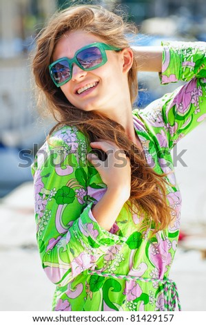 portrait of woman in sunglasses outdoors