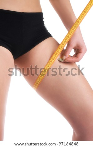 Portrait of woman measuring haunch. Isolated over white background