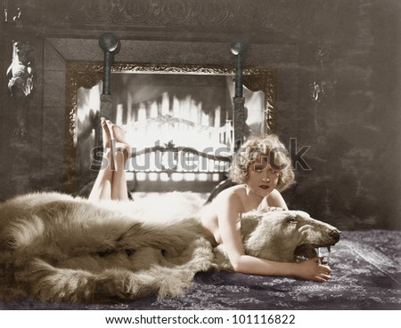 Portrait of woman on bear rug with fireplace