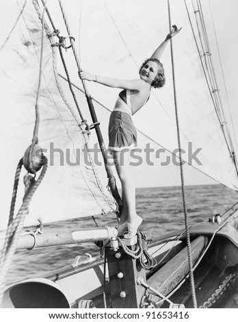 Portrait of woman on sailboat #91653416