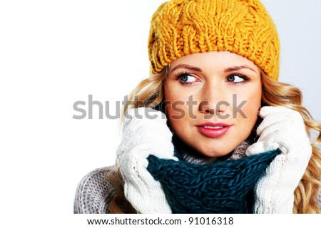 Portrait of woman on white background wearing woolen accessories