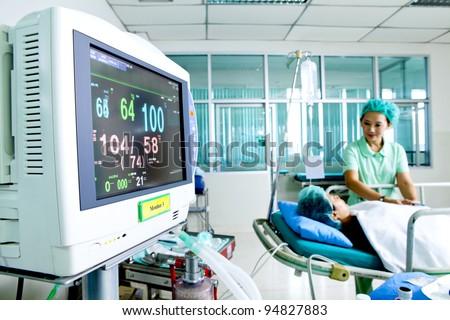 Portrait of woman patient receiving artificial ventilation in hospital