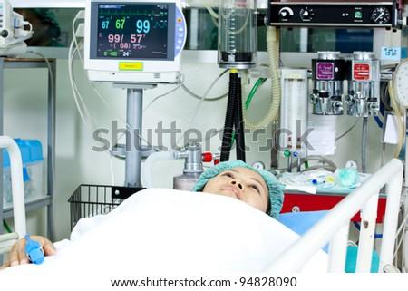 Portrait of woman patient receiving artificial ventilation in hospital - stock photo