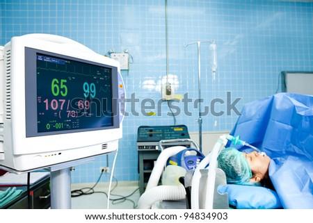 Portrait of woman patient receiving artificial ventilation in hospital - Shutterstock ID 94834903