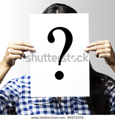 portrait of woman peaking behind of interrogation symbol over blue background