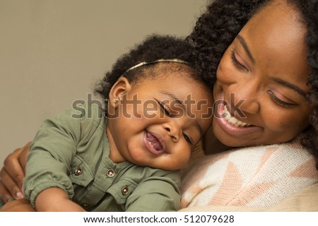 Portrait of woman relaxing at home with her little girl.