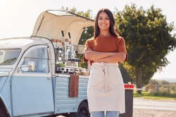 Portrait Of Woman Running Independent Mobile Coffee Shop Standing Outdoors Next To Van