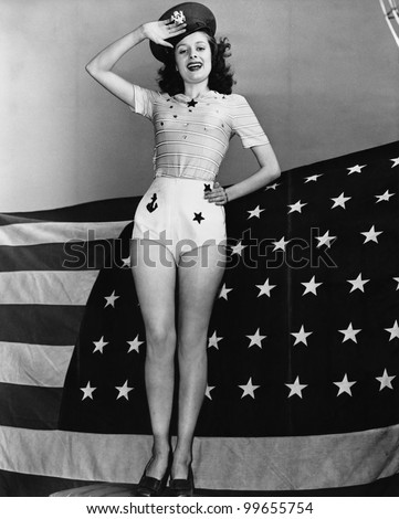 portrait of woman saluting with ...