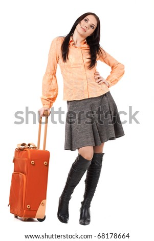 Portrait of woman standing with her suitcase