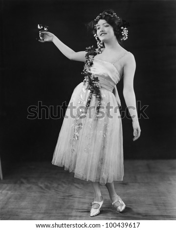 Portrait of woman toasting with glass