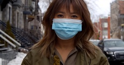 Portrait of woman wearing face mask  during coronavirus pandemic protecting herself against pathogens