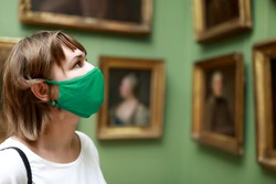 Portrait of woman wearing protection mask in museum