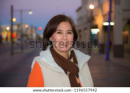 Portrait of woman with a blurry background. A sample of photography with a blurry background and sharp subject, using a wide aperture lens technique (for photography courses).