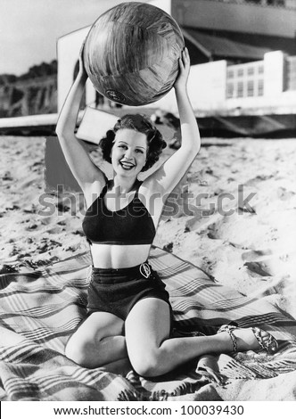 portrait of woman with ball at...
