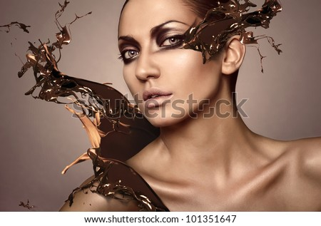 portrait of woman with chocolate splash