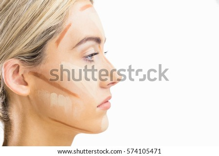 Portrait of woman with contouring makeup in a studio #574105471