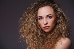 Portrait of woman with curly hair