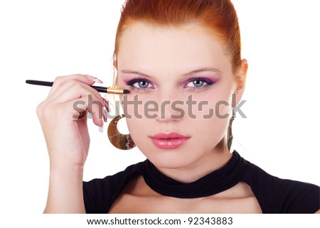 Portrait of woman with eyshadow brush isolated on white