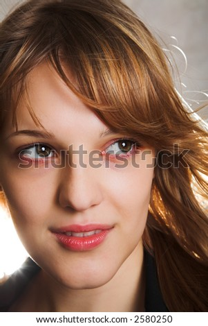 portrait of woman with flying hair and back lighting