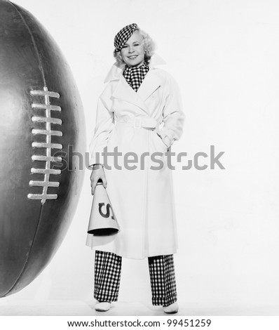 Portrait of woman with huge football