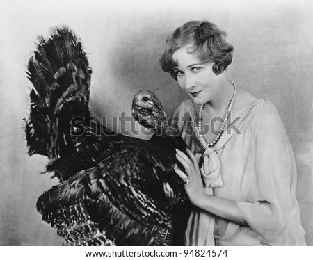 Portrait of woman with live turkey - stock photo