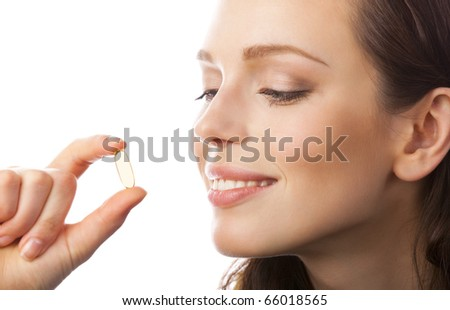 Portrait of woman with Omega 3 fish oil capsule, isolated on white background