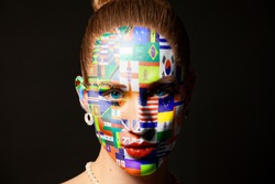 Portrait of woman with painted with Flags all countries of world isolated on black