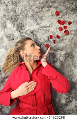 Portrait of woman with rose petals #64623298
