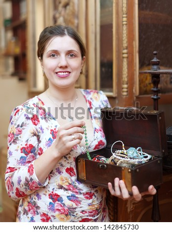 portrait of  woman with treasure chest in vintage interior