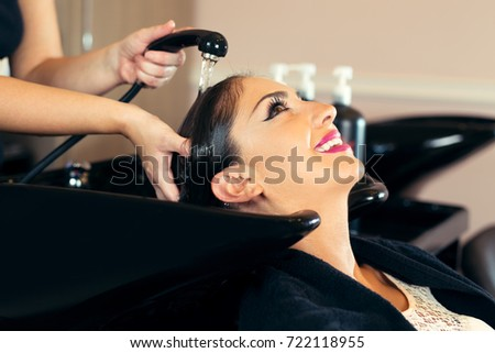 Portrait of women which wash hair in a beauty salon #722118955