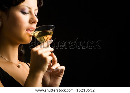 Portrait of wonderful woman drinking alcoholic cocktail
