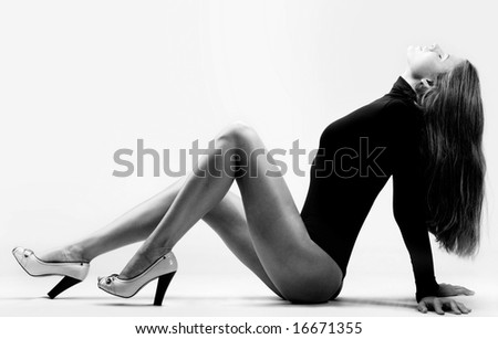 Portrait of wonderful woman sitting in perfect pose