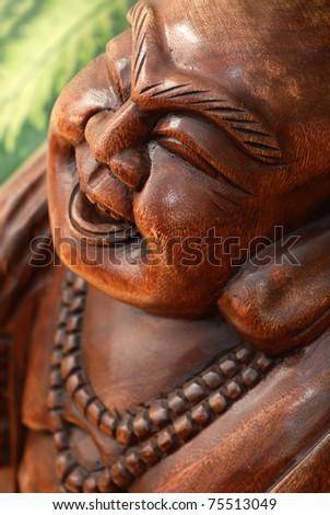 Portrait of wooden Buddha statue